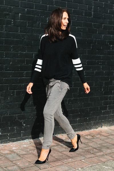 Athleisure gray cargo leggings and black striped sweater