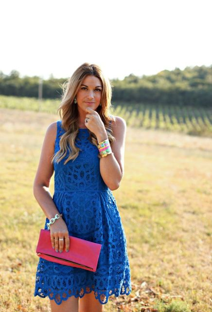 cobalt blue lace dress and red clutch