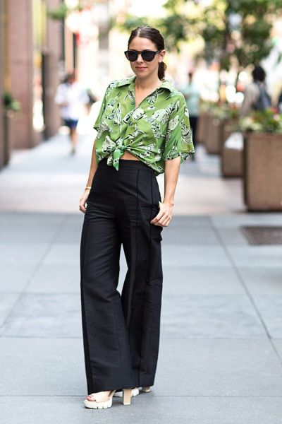black wide leg trousers and floral blouse