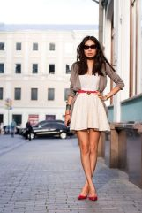 white A line dress with beige pullover and red flat shoes