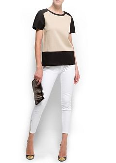 two toned top with white skinny jeans
