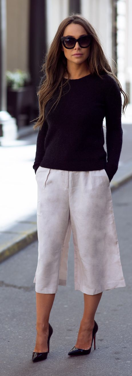 white culottes and black sweater