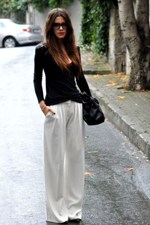 white wide leg pants and black sweater
