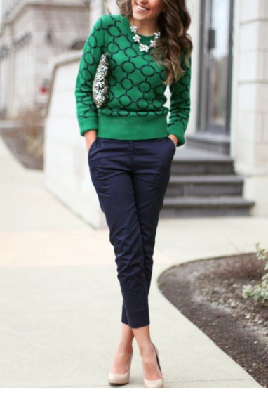 green sweater with blue skinny pants